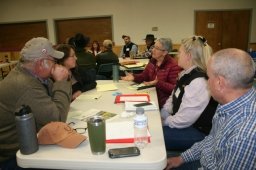 Group of ranchers discussing what they are learning at the workshop.