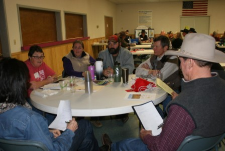 Group of ranchers at a workshop in Halfway, Oregon seated at a table.